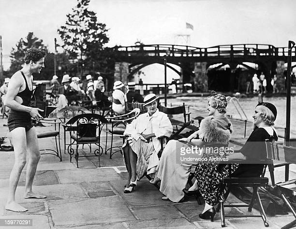 Rudy Vallee tries his skills with the camera at the Beach Casino of the Westchester Country Club in NY Rye New York June 29 1933