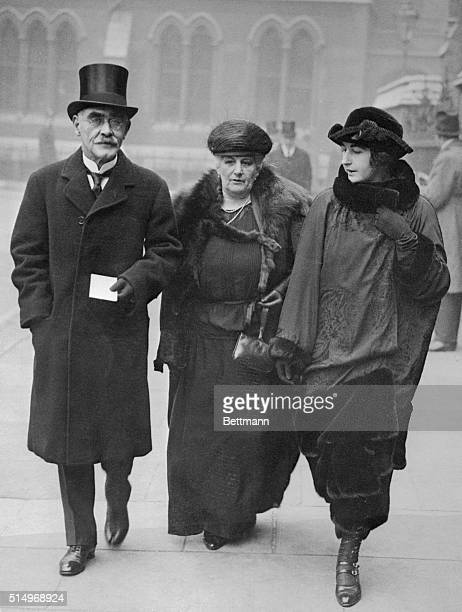 Rudyard Kipling is shown with his wife and daughter.