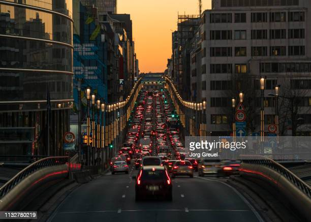 rue de la loi at dusk - traffic stock pictures, royalty-free photos & images