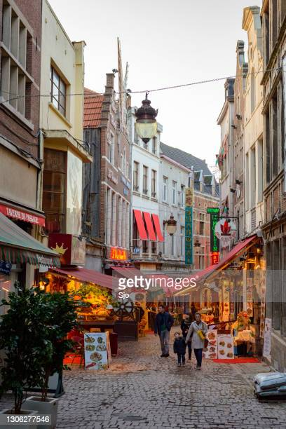 "rue des bouchers or beenhouwersstraat with restaurants and bars in brussels - ""sjoerd van der wal"" or ""sjo"" stock pictures, royalty-free photos & images"