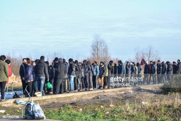 Rue du Beau Marais Calais Migrants waiting for food After the destruction of jungle camp in October 2016 migrants in Calais have been receiving food...
