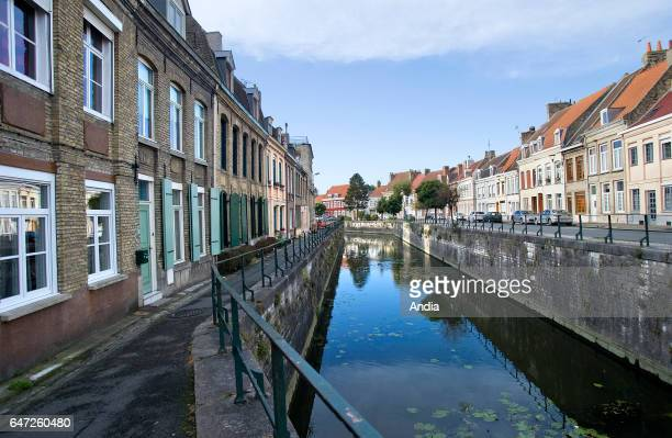 Rue du Port street in the city of Bergues with its traditional Flemish houses along the canals