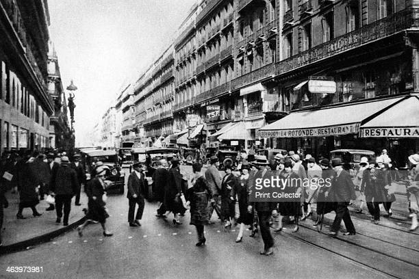 Rue Lafayette at shopping time Paris 1931 Illustration from the book Paris published by Ernest Flammarion