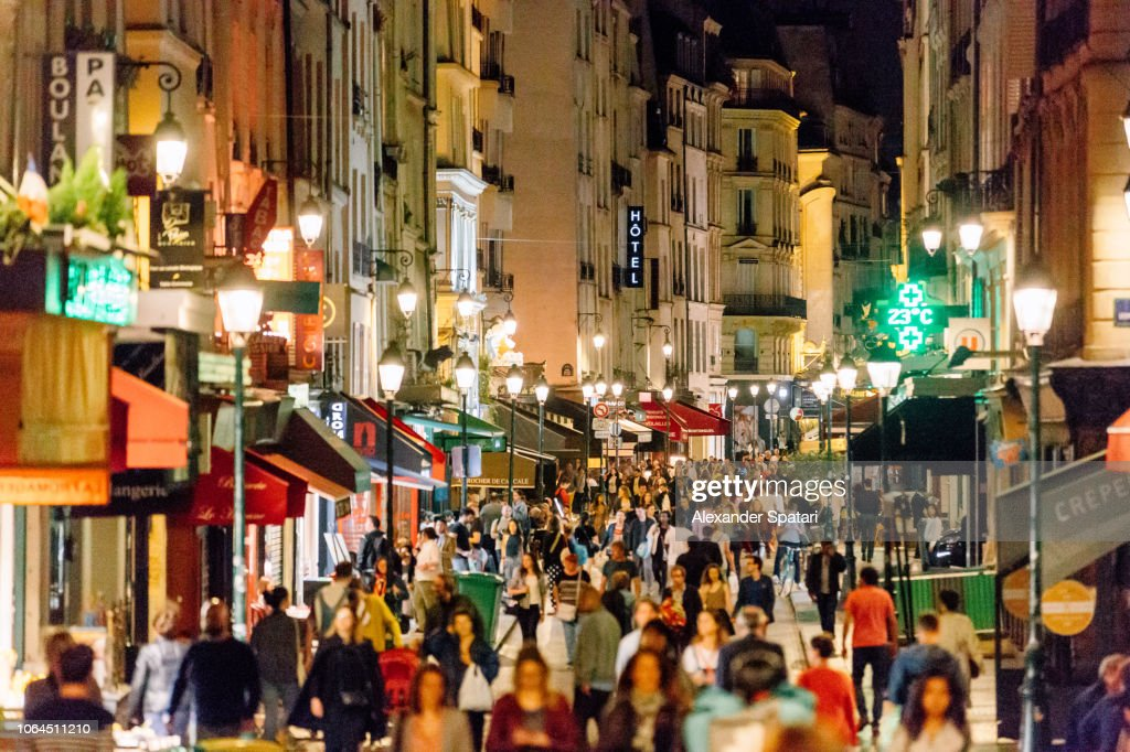 Rue Montorgueil pedestrian street with multiple restaurants and intense nightlife, Paris, France : Stock Photo