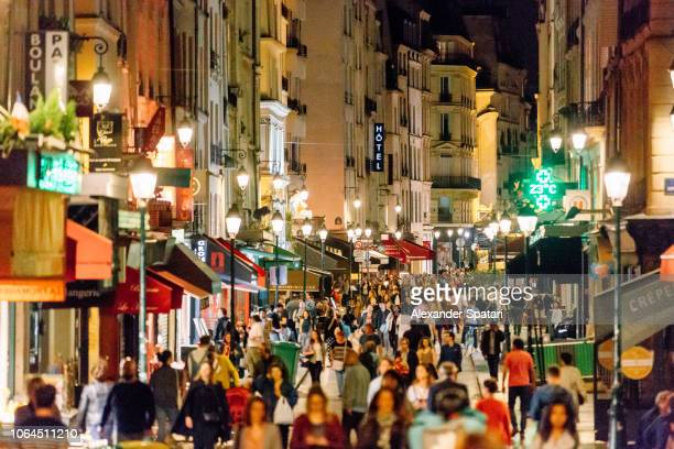 rue montorgueil pedestrian street with multiple restaurants and intense nightlife, paris, france - pedestrian zone stock pictures, royalty-free photos & images