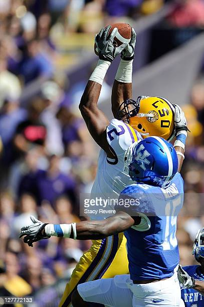 Rueben Randle of the Louisiana State University Tigers catches a pass over Martavious Neloms of the Kentucky Wildcats during a game being held at...