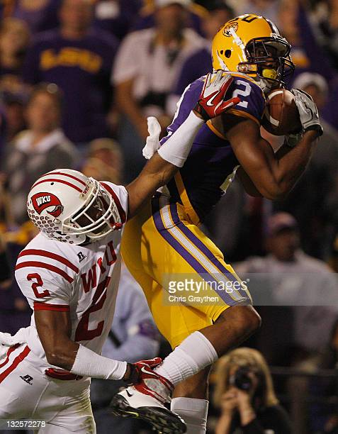 Rueben Randle of the Louisiana State University Tigers catches a touchdown pass over Derrius Brooks of the Western Kentucky Hilltoppers at Tiger...
