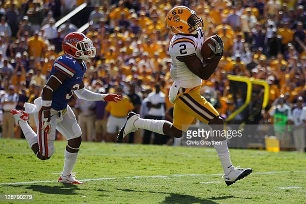 Rueben Randle of the Louisiana State University Tigers scores a touchdown pass over Cody Riggs of the Florida Gators at Tiger Stadium on October 8...