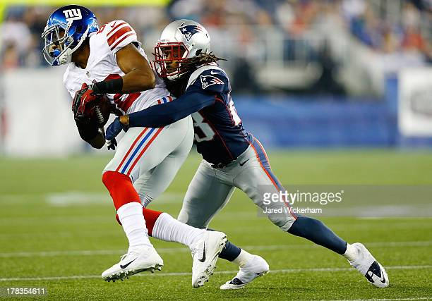 Rueben Randle of the New York Giants catches a pass in front of Marquice Cole of the New England Patriots in the second quarter during the preseason...