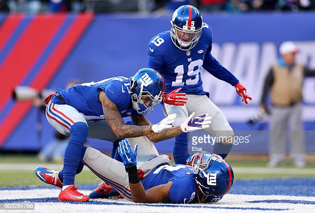 Rueben Randle of the New York Giants celebrates with his teammates Odell Beckham and Myles White after scoring a 45 yard touchdown in the third...