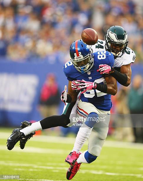 Rueben Randle of the New York Giants has a pass broken up by Bradley Fletcher of the Philadelphia Eagles in the second quarter during their game at...