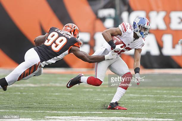 Rueben Randle of the New York Giants runs the ball upfield during the game against the Cincinnati Bengals at Paul Brown Stadium on November 11 2012...