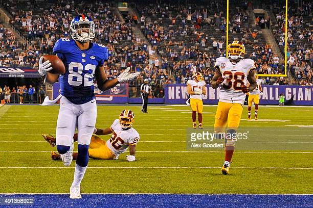 Rueben Randle of the New York Giants scores a touchdown during a game against the Washington Redskins at MetLife Stadium on September 24 2015 in East...