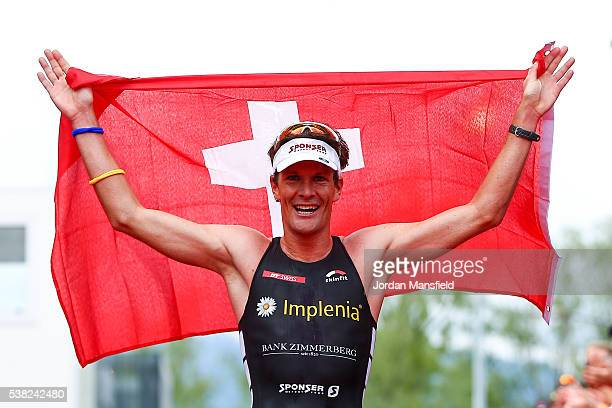 Ruedi Wild of Switzerland celebrates as he crosses the line to come second in the RapperswillJona Ironman on June 5 2016 in Rapperswil Switzerland