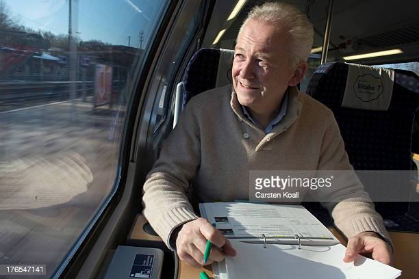 Ruediger Grube CEO of Deutsche Bahn AG and DB Mobility Logistics AG looks through the window while travelling by a Deutsche Bahn regional express...
