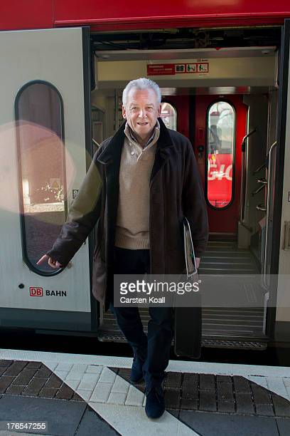 Ruediger Grube CEO of Deutsche Bahn AG and DB Mobility Logistics AG steps off the train after travelling by a Deutsche Bahn regional express train...