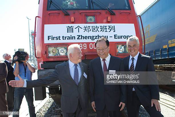Ruediger Grube CEO of German railway company Deutsche Bahn Ma Yi mayor of Zhengzhou and Frank Horch Hamburg's economy minister pose in front of the...