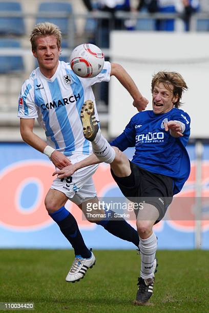 Ruediger Kauf of Bielefeld kicks the ball right infront of Stefan Aigner of Muenchen during the Second Bundesliga match between Arminia Bielefeld and...