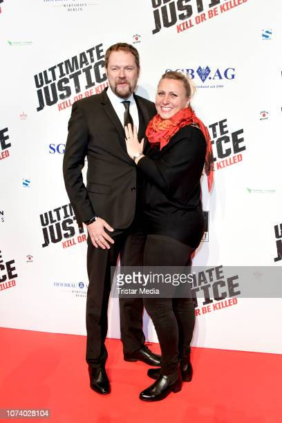 Ruediger W Kuemmerle alias Brandon Rhea and his wife during the 'Ultimate Justice' premiere at Kino Alexa on December 14 2018 in Berlin Germany