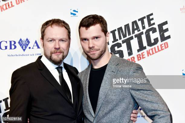 Ruediger W Kuemmerle alias Brandon Rhea and Martin Baden during the 'Ultimate Justice' premiere at Kino Alexa on December 14 2018 in Berlin Germany