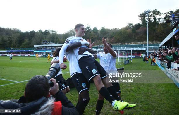 Ruel Sotiriou of Dover Athletic celebrates after scoring his team's first goal with team mates during the FA Cup First Round match between Dover...