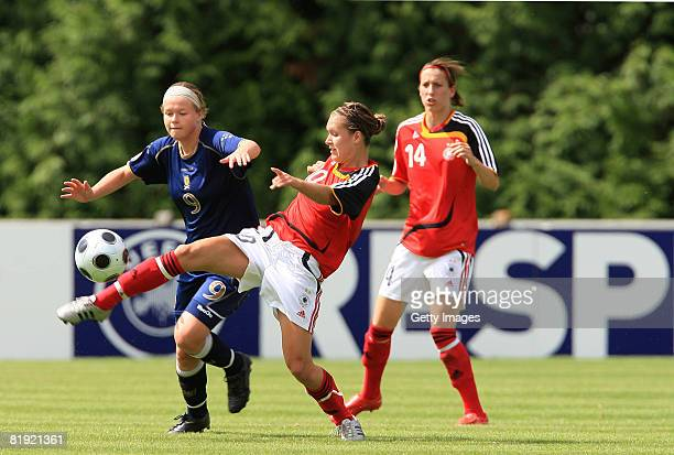 Ruesla LittleJohn of Scotland and Francesca Weber of Germany fight for the ball during the Women's U19 European Championship match between Scotland...