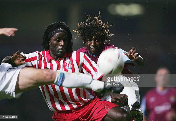 Rufus Brevett of West Ham and Ade Akinbiyi of Stoke compete for the ball during the CocaCola Championship match between West Ham United and Stoke...
