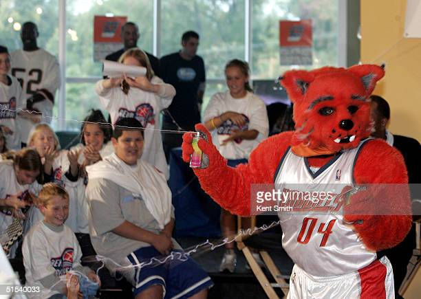 Rufus of the Charlotte Bobcats sprays children with silly string during the Read to Achieve event on October 21 2004 at the Harris YMCA Teen Center...