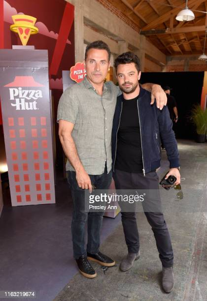 Rufus Sewell of 'The Man in the High Castle' and Dominic Cooper of 'Preacher' attend the Pizza Hut Lounge at 2019 ComicCon International San Diego on...
