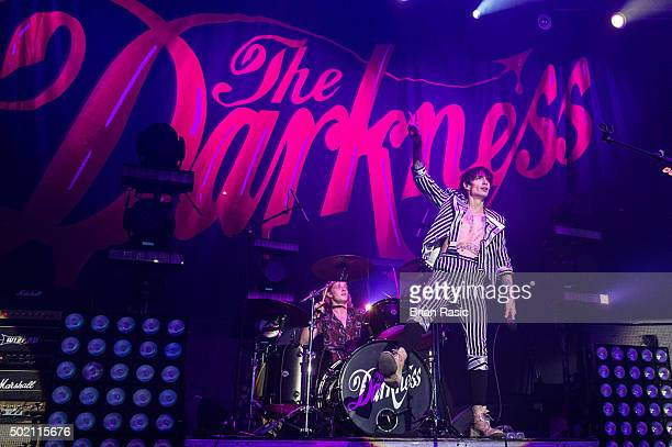 Rufus Tiger Taylor and Justin Hawkins of The Darkness perform at The Roundhouse on December 20 2015 in London England