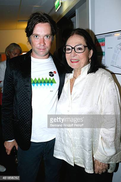 Rufus Wainwright and actress Nana Mouskouri attend the concert of 'Rufus Wainwright' at Salle Pleyel on July 6 2014 in Paris France
