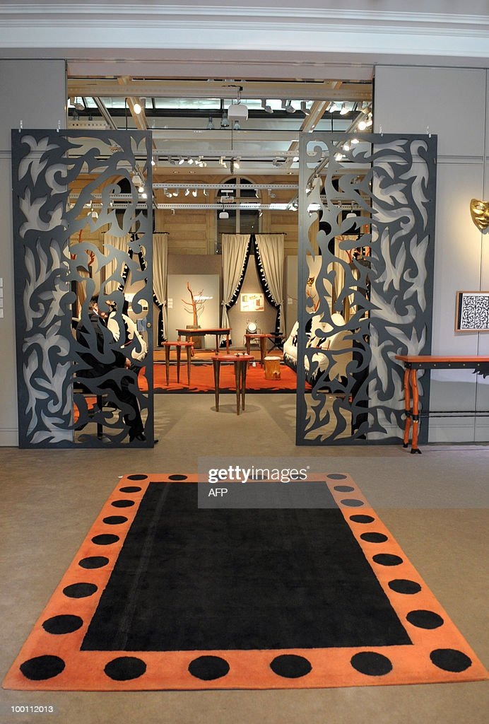 Rug and gates designed by Elizabeth Garouste and Mattia Bonetti for French fashion house Christian Lacroix are among about 100 lots exhibited at the auction house Sotheby's France in Paris on May 21, 2010 before a sale on May 26, 2010 organised at the initiative of Christian Lacroix Company. In 1987 Christian Lacroix hired furniture designers Garouste and Bonetti to create the complete bespoke interior of his fashion house located on the Parisian Faubourg Saint Honore. Apart from the salons, the team also designed the packaging, the writing paper, the logo.