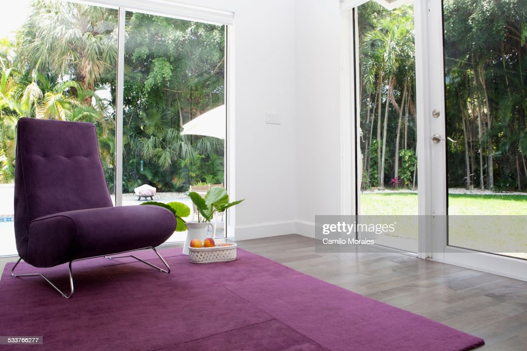 Rug, chair and windows in modern living room : Foto stock