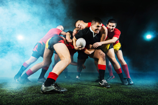 Rugby action at night. 186546636