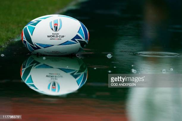A rugby ball is seen in a puddle of rainwater during South Africa's Captain's Run session at the International Stadium Yokohama in Yokohama on...