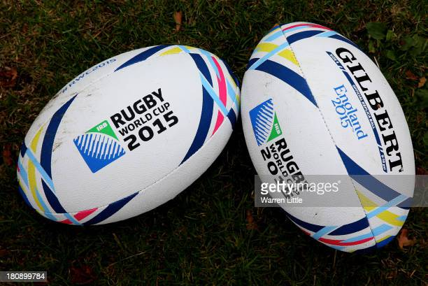 Rugby balls are pictured as Lawrence Dallaglio coaches local children who will have first access to the newly installed posts at Inwood Park are...