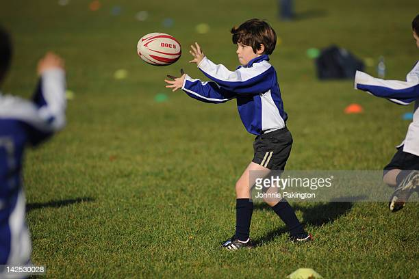 rugby boy pass - rugby stock pictures, royalty-free photos & images