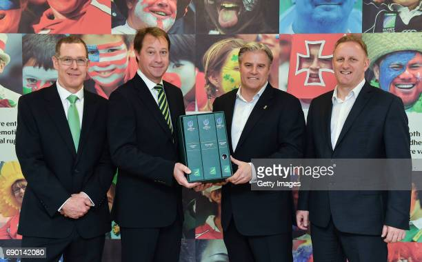 Rugby CEO Jurie Roux and Bruce Beckett left SA Rugby Bid Committee member hand in the SA Rugby bid submission for the 2023 Rugby World Cup to Brett...