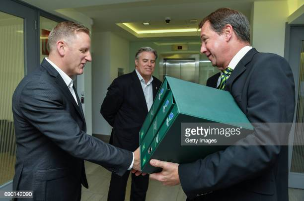 Rugby CEO Jurie Roux arrives to hand in the SA Rugby bid submission for the 2023 Rugby World Cup to Brett Gosper CEO World Rugby and Alan Gilpin left...