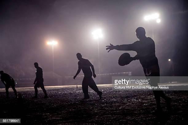 Rugby drop kick on muddy field