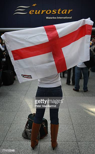 Rugby fan Laura Cook holds a flag of St George aloft before boarding a Eurostar train for Paris at Waterloo station on October 19 2007 in London...