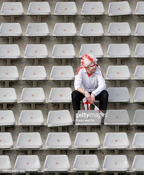 rugby fan with english flag painted on face sitting in stadium - england flag stock pictures, royalty-free photos & images