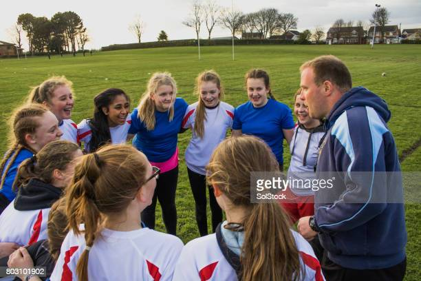 Rugby Girls Team Huddle