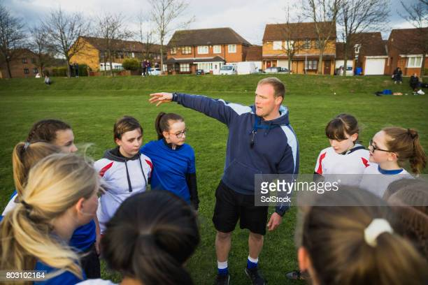 Rugby Girls Team Huddle