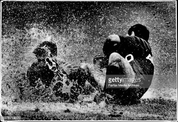 Rugby League at North Sydney OvalNorths Vs CanterburySteve Mortimer Tack John DorahyMud slush and foam flies from North Sydney Oval as Steve Mortimer...