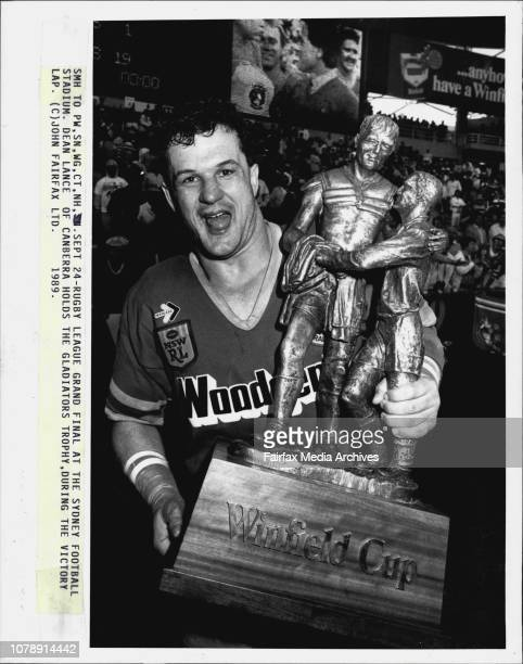 Rugby League Grand Final at the Sydney Football stadium Dean Lance of Canberra holds the gladiators Trophy during the Victory lapRugby League Grand...