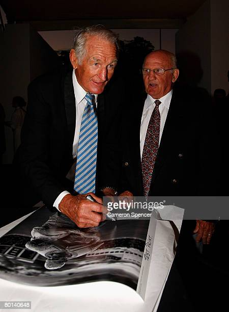 Rugby league legend Norm Provan signs a photo of himself with Authur Summons during the NRL 2008 season launch at Birchgrove Oval on March 6 2008 in...