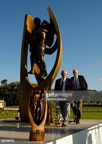 Rugby league legends Authur Summons and Norm Provan walk onto stage by the premiership trophy during the NRL 2008 season launch at Birchgrove Oval on...