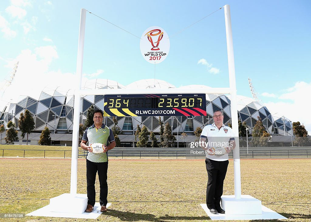 Rugby League legends Steve Renouf of Australia and Garry Schofield of Great Britain pose under the countdown clock during a media opportunity marking one year to go until the 2017 Rugby League World Cup next to AAMI park on October 27, 2016 in Melbourne, Australia.