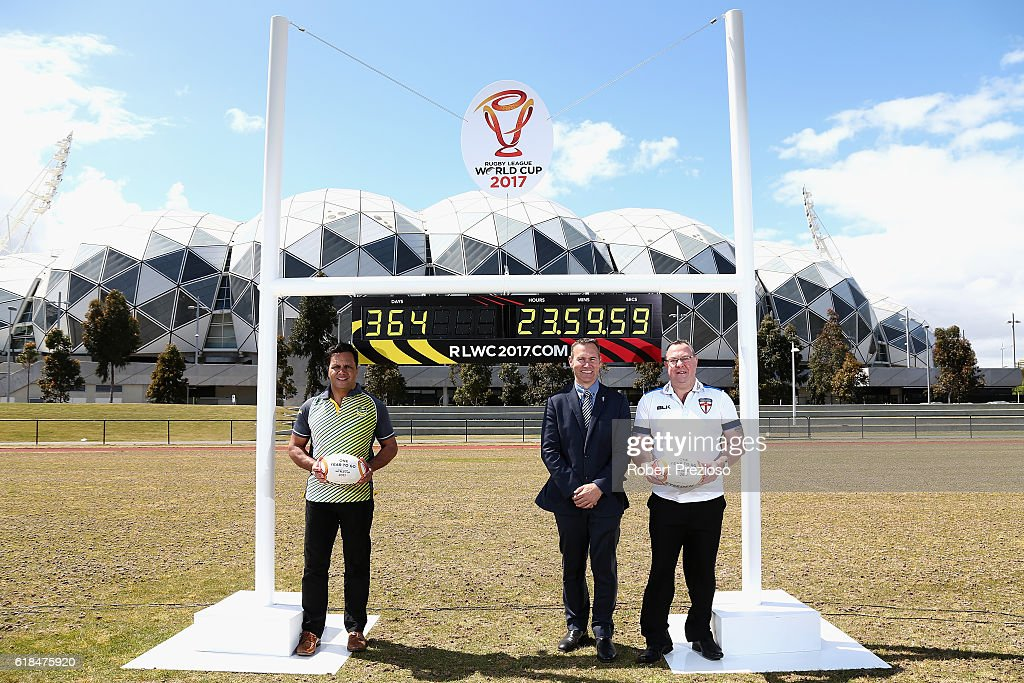 Rugby League legends Steve Renouf of Australia and Garry Schofield of Great Britain along with Andrew Hill 2017 Rugby League World Cup CEO pose under the countdown clock during a media opportunity marking one year to go until the 2017 Rugby League World Cup next to AAMI park on October 27, 2016 in Melbourne, Australia.